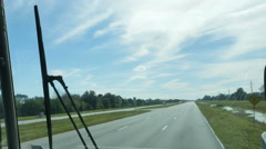 Driving Down Highway on Bus Looking Out Window Blue Skies, 4K Stock Footage