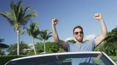 Excited Happy Man Cheering In Convertible Car Celebrating Success Winning Stock Footage