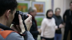 Photographer at exhibition Stock Footage