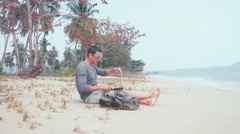 Man work on computer at the beach on the beach Stock Footage