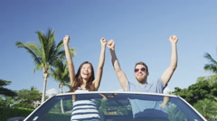 Excited Young Couple Cheering In Convertible Car Celebrating Success Cheering Stock Footage