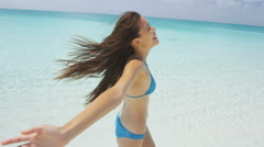 Playful Woman Walking On Beach During Summer Travel Vacation Having Fun Stock Footage