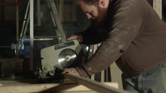 Carpenter Cutting Through Lumber with Compound Miter Saw Stock Footage