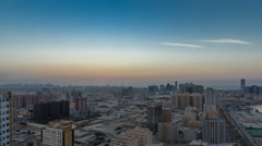 Cityscape of Ajman from rooftop day to night timelapse. Ajman is the capital of Stock Footage
