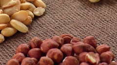 Almonds, cashew, walnuts and hazelnuts lying on burlap Stock Footage