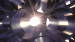 Rows of Metal Pipes with reflections and Sun Flares inside. - stock footage