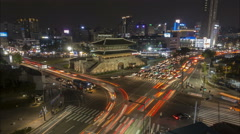 Contrast modern and historic, night time lapse skyline Seoul, South Korea Stock Footage