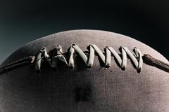 Close up of stitching on american football Stock Photos