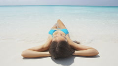 Beach Woman Sunbathing Relaxing In Sand Water Edge On Travel Vacation Holidays Stock Footage