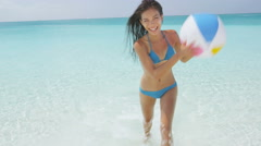 Excited Woman Holding Beach Ball Coming Out Of Sea On Travel Vacation Holidays Stock Footage