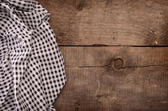 Checkered table cloth on wood Stock Photos