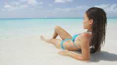 Attractive Woman Reclining On Beach During Summer On Travel Vacation Holidays - stock footage