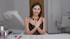 Beauty Parlour. A happy girl shows off her new manicure. Red nail Stock Footage