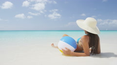 Beach Woman Relaxing Lying In Sand in Paradise On Travel Vacation Holidays - stock footage
