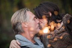 Affectionate mature couple with light from sparkler Stock Photos