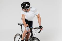 Male cyclist looking over shoulder Stock Photos