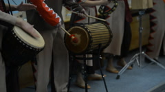 A group of people in costumes playing the African drums Arkistovideo