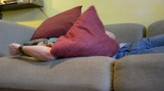 Young Man Sleeping on the Couch at Home Stock Footage