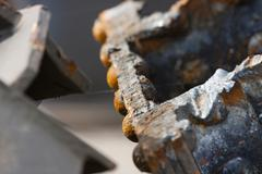 Detail shot of cut rusty steel beams from an old bridge. Stock Photos