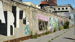 graffiti on the dirty wall in the city - stock footage