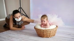 Little infant baby model in photo studio posing during shooting pictures Stock Footage