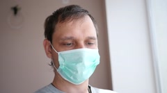 Man taking selfie picture via smartphone posing in antiviral bandage on mouth Stock Footage