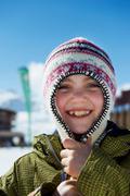 Smiling girl wearing knitted cap Stock Photos
