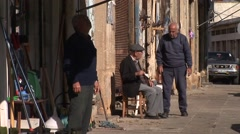 Greek Cypriot shopkeepers sit outside stores, Nicosia Stock Footage