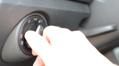 Man turns off daylight of modern car - detail of dashboard Stock Footage