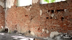 old destroyed brick building - sun shines - stock footage