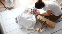 Photographer attempt to clam down and lull baby during photo shot process Stock Footage