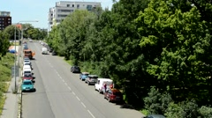 outlook from the bridge on the road and the city in the distance - stock footage