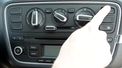 Man turns on warning lights on the control panel in the modern car Stock Footage