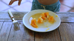 Child eating oranges with fork - stock footage