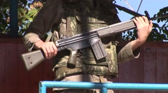 Machine gun, tilt up to young man, a Greek Cypriot army conscript Stock Footage