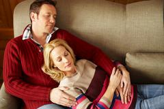 Couple sleeping on sofa together Stock Photos