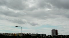 View of the dark clouds on the blue sky above the city and prefab housing estate Stock Footage