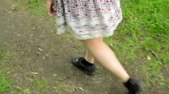 Feet walks in the park - young woman - close up - stedicam Stock Footage