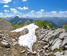 Last snow in the Allgau Alps - stock photo