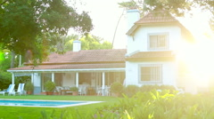Shot of a home during golden hour / Establishing shot of ideal family home durin Stock Footage