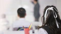 4K Happy school children in class run to high five their teacher. - stock footage