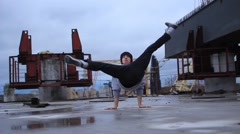 B-boy dancing break dance in the industrial zone. Stock Footage