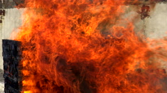 The fire extinguishing foam on a wooden object in motion. Stock Footage