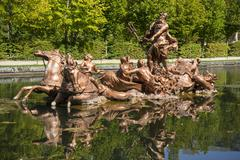 Golden fountains in segovia palace in Spain. bronze figures of mythological g Stock Photos