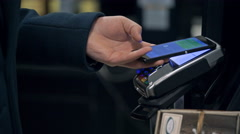 Contactless payment with your smartphone. Paying with a smartphone device on a Stock Footage