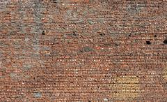 Texture of old grunge dirty brick wall with peeling plaster Stock Photos