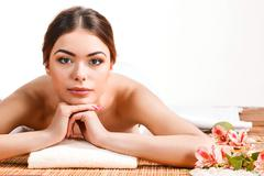 Beautiful young woman at a spa salon - stock photo