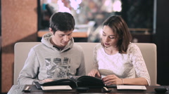 Young couple making a choice in a restaurant Stock Footage