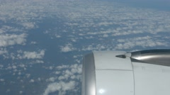 Stock Video Footage of Airborne Perspective of Altocumulus Clouds taken over Engine of Airliner