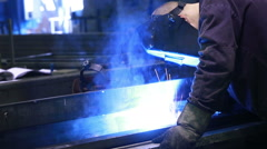 Worker with protective mask welding metal - stock footage